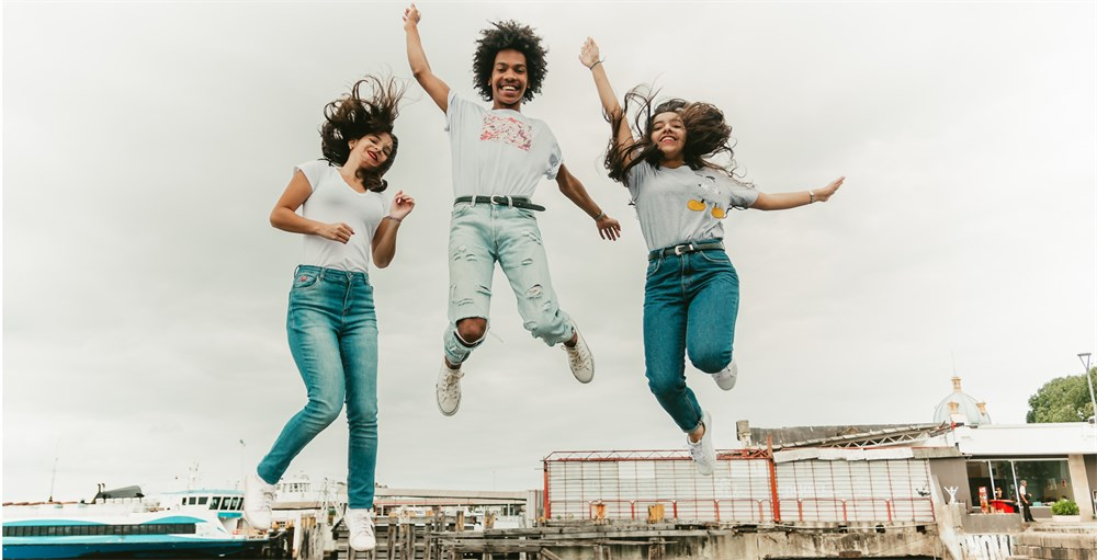 Group of young people celebrating financial freedom