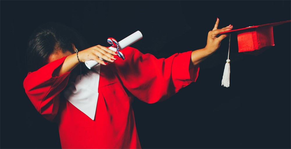 college student in red graduation gown