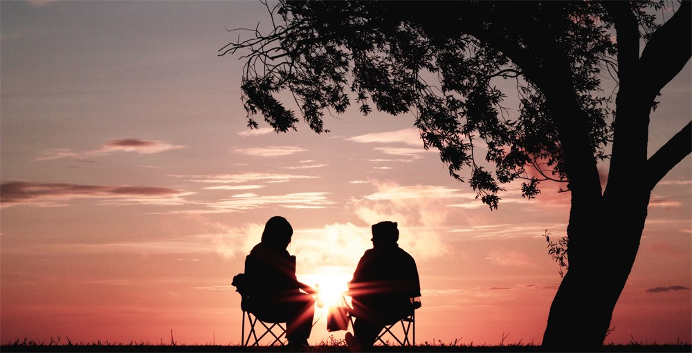 couple in sunset talking about retirement
