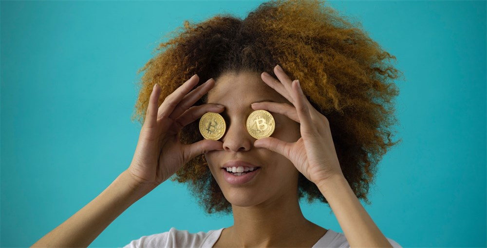 woman covering her eyes with two round gold-colored coins